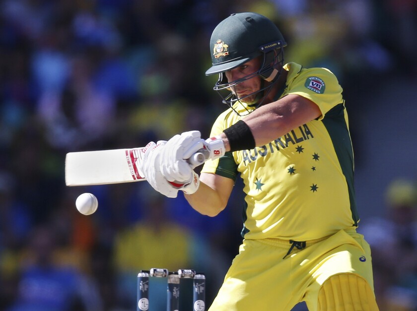 FILE - In this March 26, 2015, file photo, Australia's Aaron Finch plays a shot while batting against India during their Cricket World Cup semifinal in Sydney. Finch, Australia's limited-overs cricket captain, is prepared to spend long periods of time in isolation if it means the sport can continue being played in the coronavirus pandemic. (AP Photo/Rick Rycroft, File)