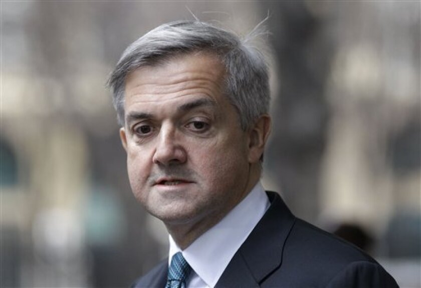 Former government Energy Secretary Chris Huhne speaks to the media outside Southwark Crown Court in London Monday Feb. 4, 2013, after he pleaded guilty to the charge of obstruction of justice for persuading his then wife Vicky Pryce to say she had been driving the car, so he could avoid a driving ban. Member of Parliament Huhne resigned from the cabinet after the Crown Prosecution Service announced that he and Pryce would face charges, and told reporters outside court that he would be resigning from his parliamentary seat. (AP Photo/Sang Tan)