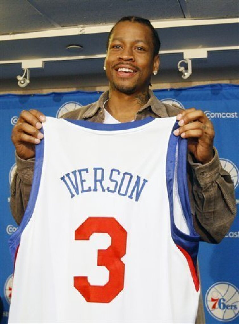 Newly-acquired Philadelphia 76ers guard Allen Iverson holds up his new jersey after a basketball news conference, Thursday, Dec. 3, 2009, in Philadelphia. (AP Photo/Matt Slocum)