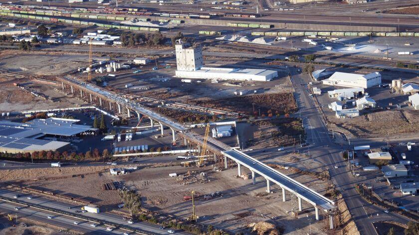 The California bullet train's Cedar Viaduct alongside SR 99 in Fresno.