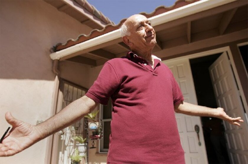 """Sam Kazanchi, who lives on Mount Soledad in La Jolla, was among the 65 homeowners who sued the city of San Diego over damage caused by the October 2007 landslide. He called yesterday's Superior Court ruling unfortunate but said, """"The law is the law."""" (John Gastaldo / Union-Tribune)"""