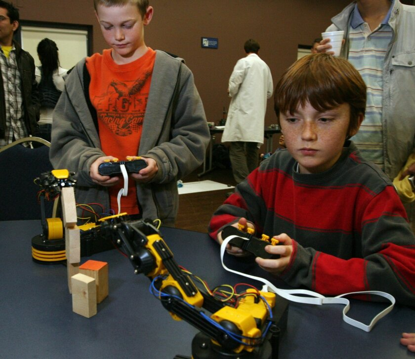 Wil Corbin, 10, left, and Arthur Couturier, 11, use factory-made robots at Cal State San Marcos in December 2011. BILL WECHTER | File photo