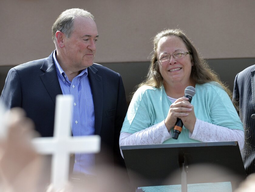 Rowan County Clerk Kim Davis, with Republican presidential candidate Mike Huckabee, left, at her side, speaks after being released from the Carter County Detention Center in Grayson, Ky., on Tuesday.