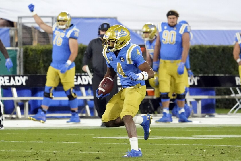 UCLA defensive back Stephan Blaylock runs with the ball after intercepting a pass against Arizona.