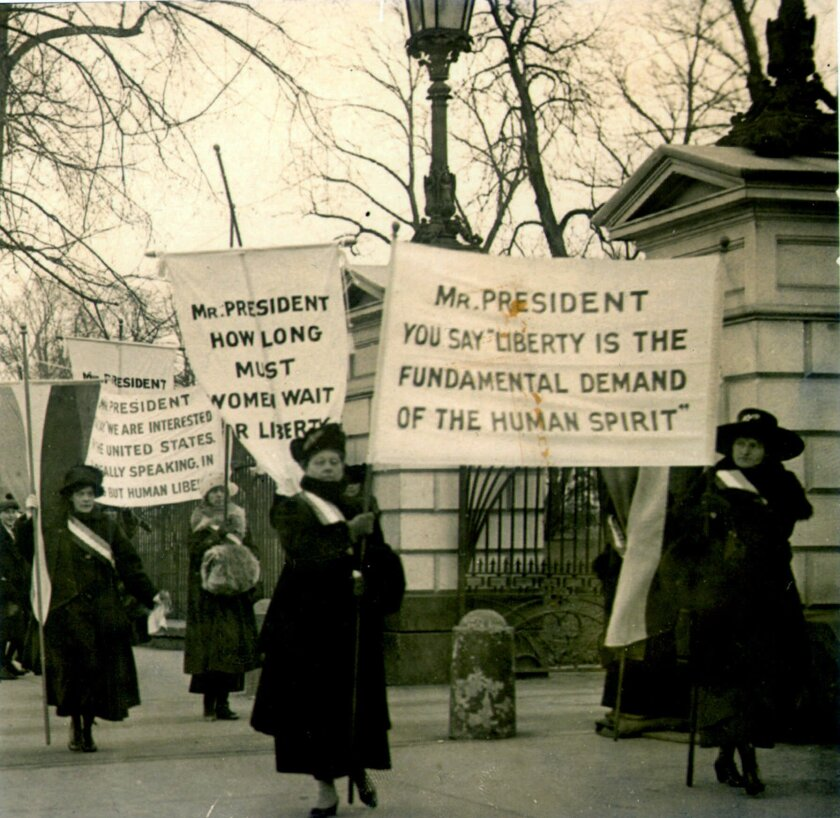 Women demonstrate outside the White House demanding voting rights, circa 1918.