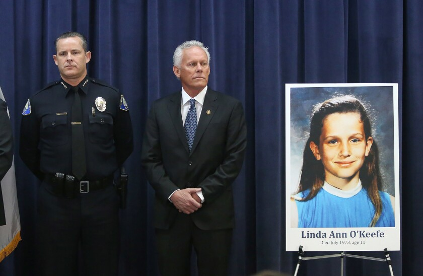 Newport Beach Police Chief Jon Lewis, left, and Newport Beach Council Member Brad Avery, stand at pr