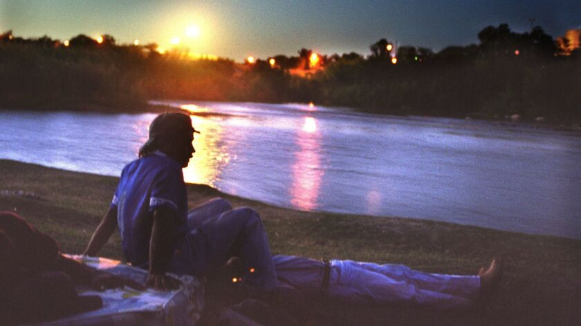 U.S. Border Patrol security lights illuminate Zacate Creek on the Laredo side of the Rio Grande on the night of May 21, 2000.