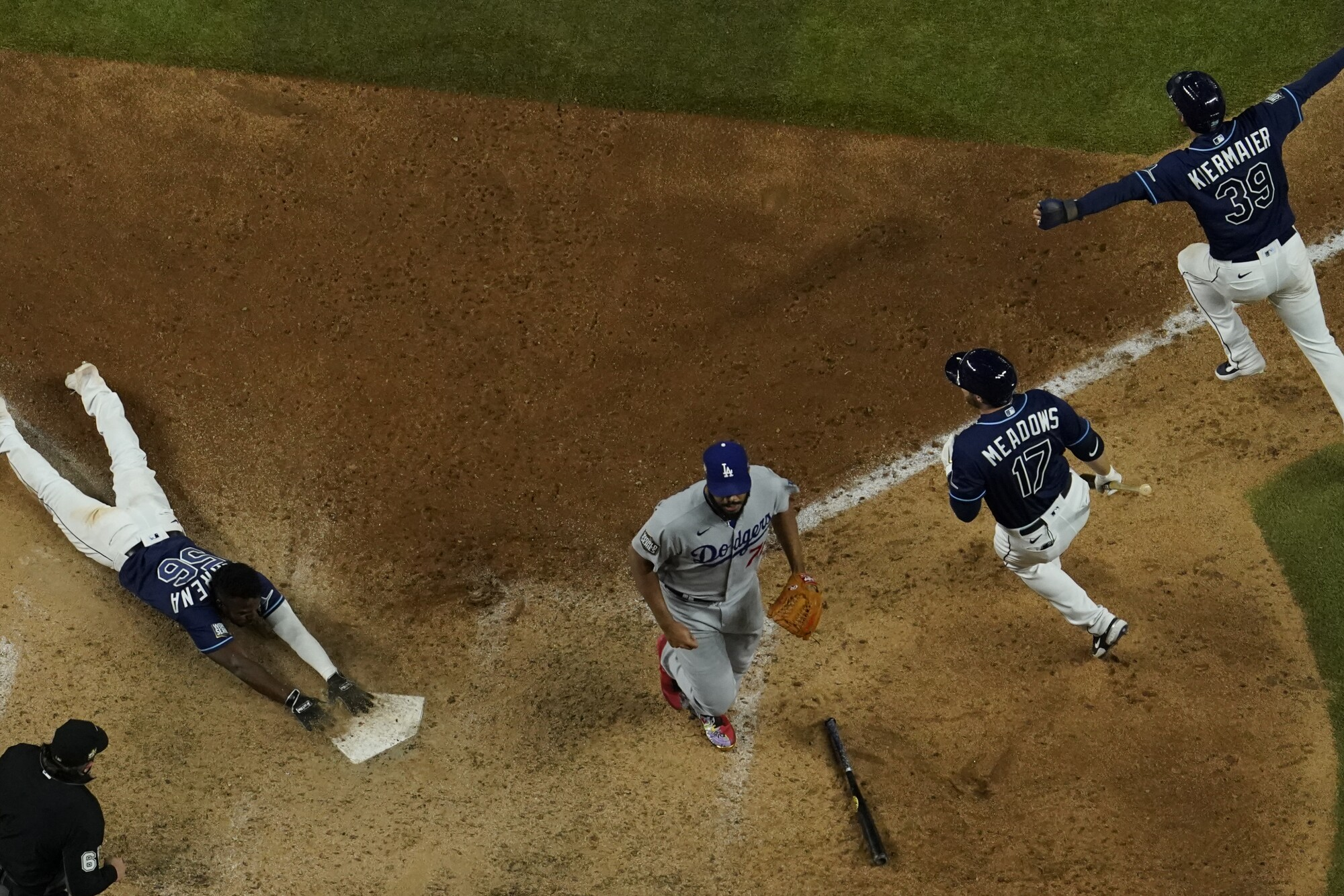 Tampa Bay's Randy Arozarena scores the winning run against the Dodgers in Game 4 of the World Series.