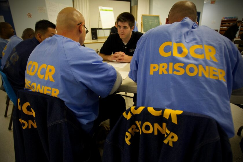 San Diego State University student Kris Rosson works with inmates at Donovan Correctional Facility. Rosson is among the group of SDSU students that help Professor Paul Sutton teach writing skills to inmates.