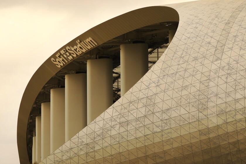 "An exterior view shows the ""SoFi Stadium"" sign."