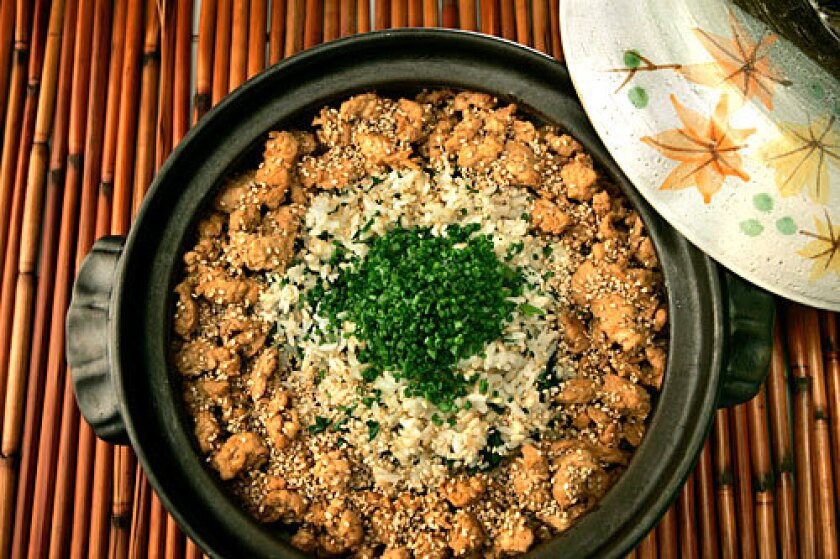JAPANESE DISH: Rice with chicken and dandelion.