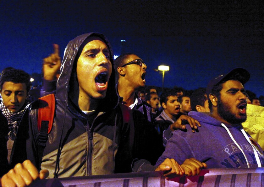 Members of Egypt's April 6 Youth Movement chant slogans against the authoritarian-minded interim government during a protest in Cairo.