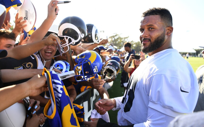Rams defensive tackle Aaron Donald signs autographs at training camp on the campus of UC Irvine on Sunday.