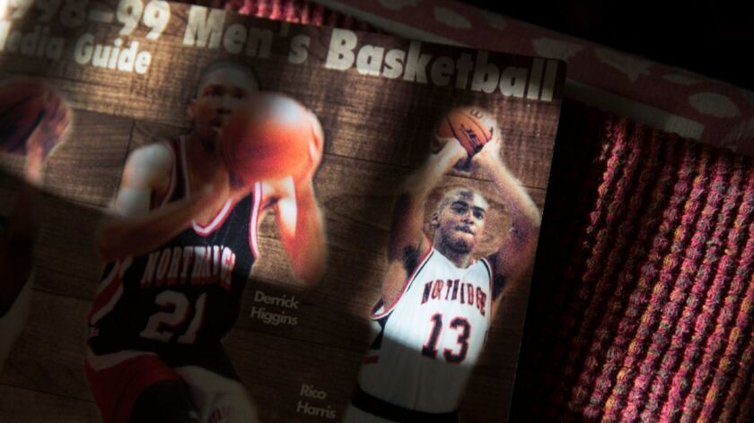 Margaret Fernandez displays a Cal State Northridge basketball media guide featuring her son, Rico Harris.