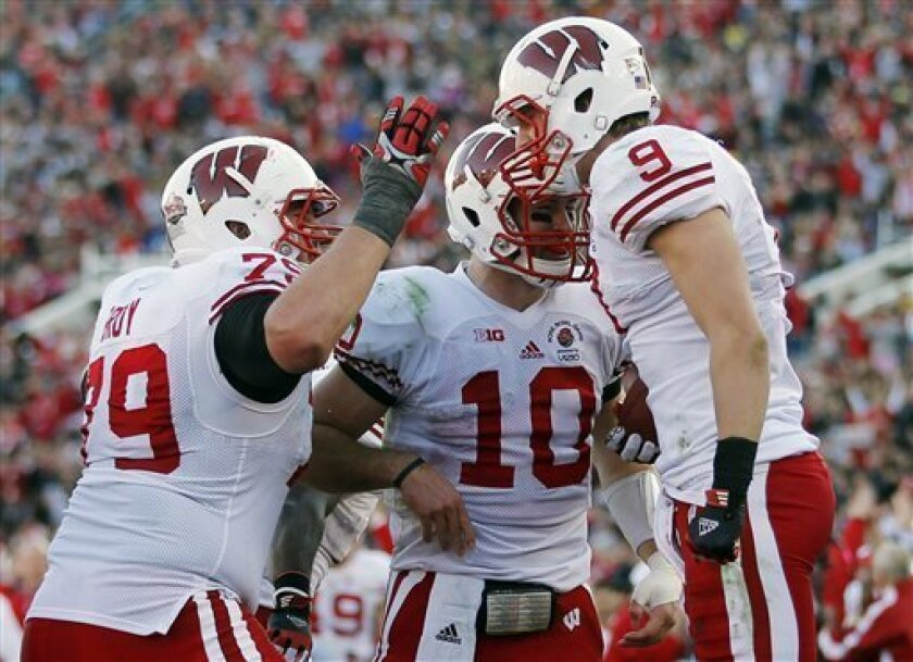 Wisconsin wide receiver Jordan Fredrick (9) celebrates with offensive lineman Ryan Groy (79) after his touchdown reception on a pass by quarterback Curt Phillips (10) during the first half of the Rose Bowl NCAA college football game against Stanford, Tuesday, Jan. 1, 2013, in Pasadena, Calif. (AP Photo/Jae C. Hong)