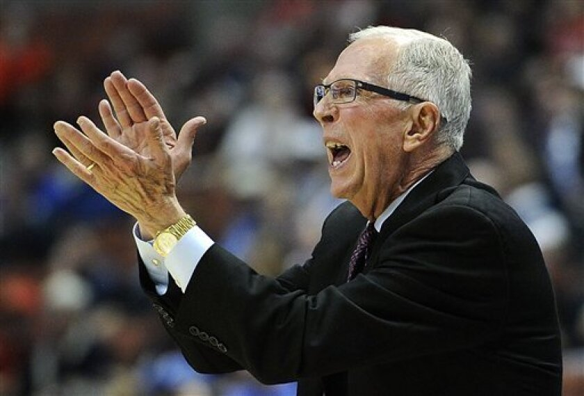 San Diego State coach Steve Fisher cheers his team during the first half of a West regional semifinal against Connecticut in the NCAA college basketball tournament, Thursday, March 24, 2011, in Anaheim, Calif. (AP Photo/Mark J. Terrill)