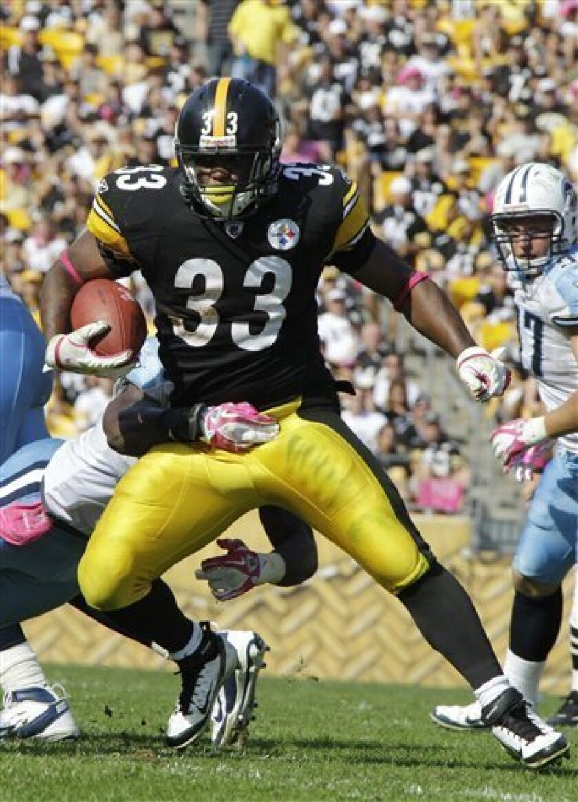 Pittsburgh Steelers running back Issac Redman (33) runs through the grasp of Tennessee Titans safety Michael Griffin during the third quarter of an NFL football game in Pittsburgh, Sunday, Oct. 9, 2011. The Steelers won 38-17. (AP Photo/Gene J. Puskar)