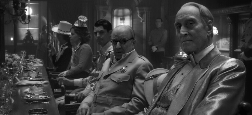 """Charles Dance, far right, stars as William Randolph Hearst with Arliss Howard as Louis B. Mayer in """"Mank."""""""