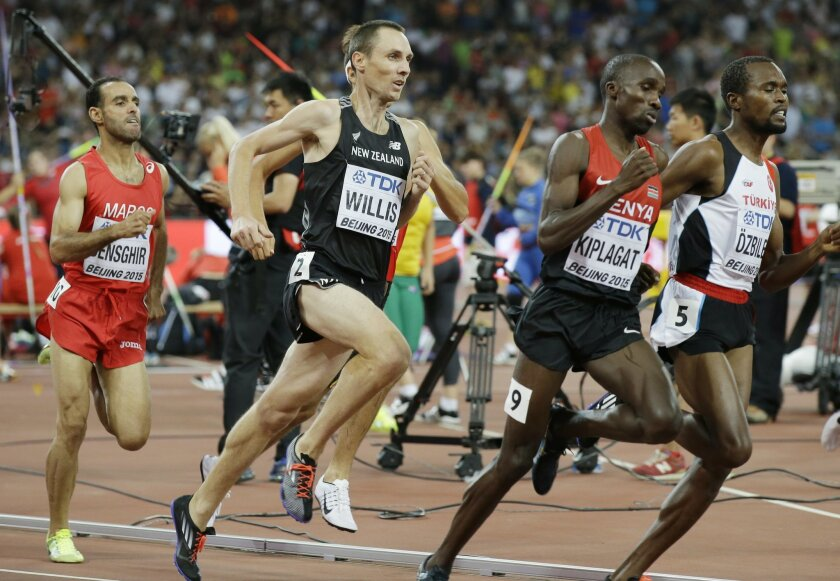 "FILE - In this Aug. 28, 2015, file photo, New Zealand's Nick Willis runs in his men's 1,500-meter semifinal at the World Athletics Championships at the Bird's Nest stadium in Beijing. Willis, who won the silver medal in the 1,500 meters at the 2008 Beijing Games, and his wife Sierra Willis, who is on his coaching staff, says, ""We've had a lot of conversations about the Zika virus. ... We have a 2½-year-old son, my wife and I, and we'd like to add to that family and grow it."" (AP Photo/Kin Cheung, File)"