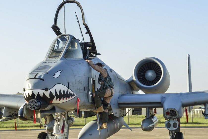 A U.S. Air Force pilot climbs out of an A-10 Thunderbolt II attack aircraft at Incirlik Air Base in Turkey.