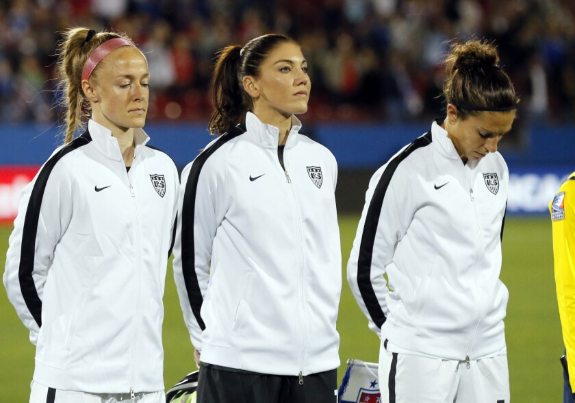 Becky Sauerbrunn, from left, Hope Solo and Carli Lloyd of the U.S. stand on the field during team introductions before a CONCACAF Olympic qualifying match against Costa Rica on Feb. 10.