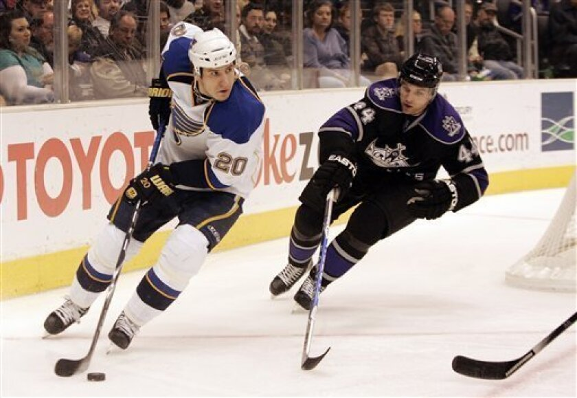 St. Louis Blues center Alexander Steen (20) moves the puck defended by Los Angeles Kings defenseman Davis Drewiske (44) in the first period of an NHL hockey game in Los Angeles on Saturday, Dec. 5, 2009. (AP Photo/Jason Redmond)