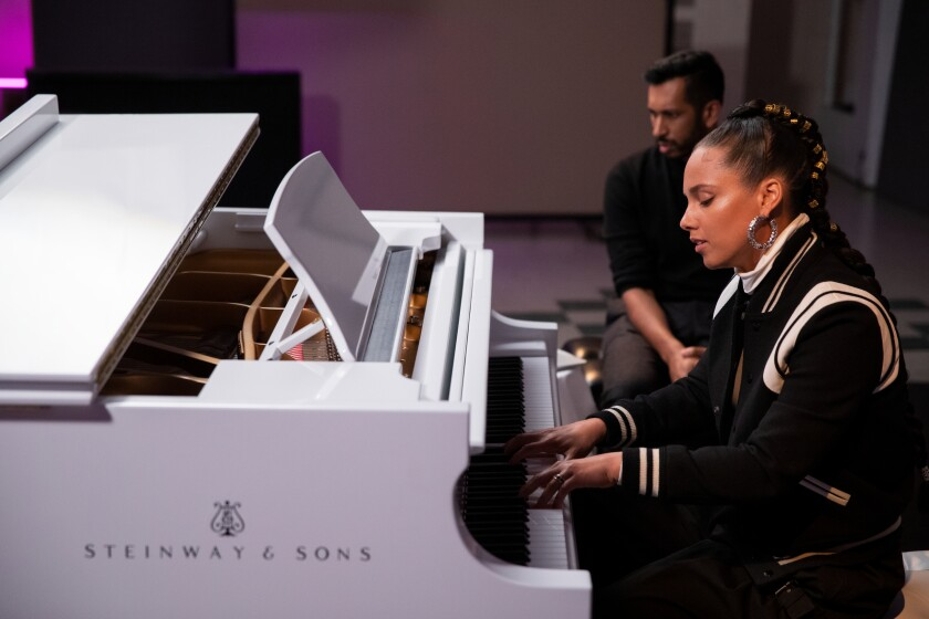 """Singer/songwriter Alicia Keys plays the piano as """"Song Exploder"""" host and creator Hrishikesh Hirway observes."""