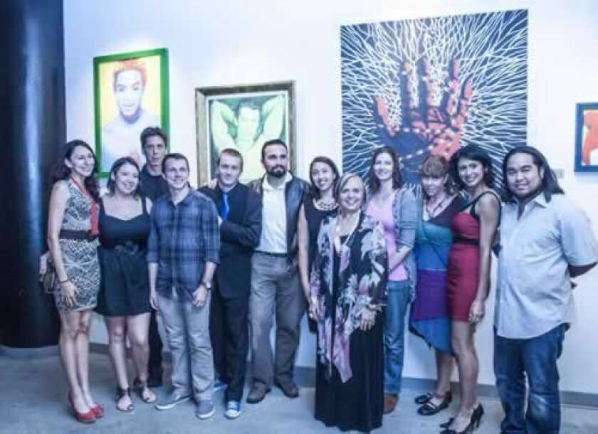 StageHANDS artists and friends gathered in front of several large-scale prints by set designer Syd Stevens (back row, third from left) event producer Andy Lowe is far right, next to Kristen Flores. Maurice Hewitt