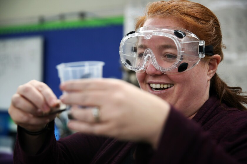 Jeanette Chipps smiles after seeing a student's successful work on a ferrofluid project at Granada Hills Charter High School. Chipps incorporates climate change into her curriculum and projects.