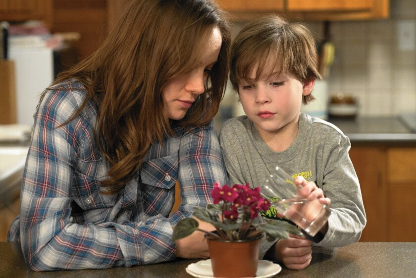 """Brie Larson and Jacob Tremblay star as a mother and son confined by an abductor inside a 10-by-10-foot garden shed for the first half of """"Room."""""""
