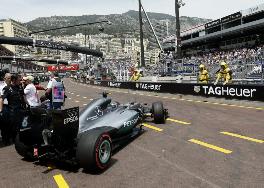 Mercedes driver Nico Rosberg of Germany steers his car out of his team garage during the second free practice at the Monaco racetrack in Monaco, Thursday, May 26, 2016. The Formula one race will be held on Sunday. (AP Photo/Petr David Josek)