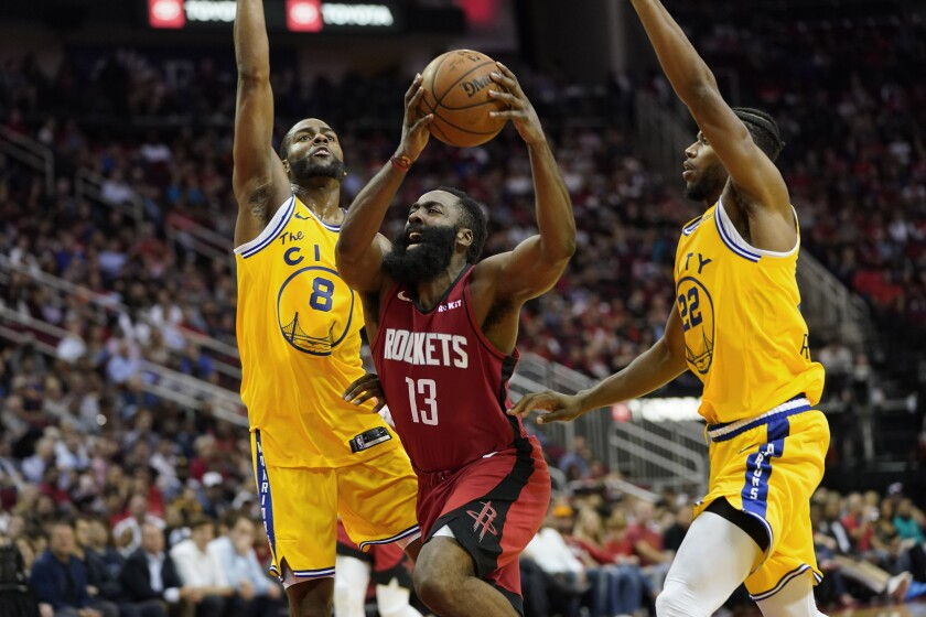 Houston Rockets' James Harden (13) is fouled by Golden State Warriors' Alec Burks (8) as Glenn Robinson III (22) helps defend during the second half of an NBA basketball game Wednesday, Nov. 6, 2019, in Houston. The Rockets won 129-112. (AP Photo/David J. Phillip)