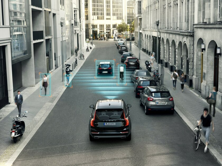 This undated photo rendering provided by Volvo Cars shows the car makers City Safety feature in one of their XC90 SUVs. City Safety features pedestrian and cyclist detection with full auto brake, day and night. (Volvo Cars via AP)