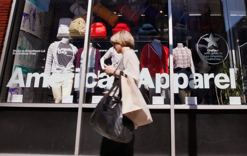 A pedestrian passes an American Apparel store in Chicago on Sept. 4, 2009.