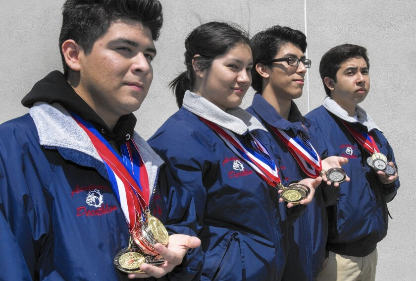 Garfield High School students Joey Nabor, left to right, Wendy Olvera, Alfonso Caballero and Brian Rios are competing in the national academic decathlon.
