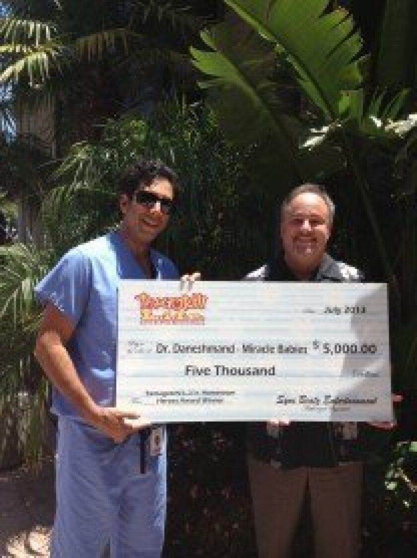 Bandai Co., Ltd. celebrates the latest recipient of its Tamagotchi L.i.f.e. Hometown Heroes Award with a $5,000 contribution to Dr. Sean Daneshmand, founder, and Kevin Robertson, executive director of San Diego-based Miracle Babies, a non-profit organization which provides support and financial ass