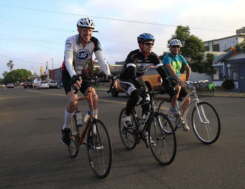 Mayoral candidate Nathan Fletcher (center) joins Bill Walton (left) and cycling advocate Ed Clancy on a Mid City bike ride to learn more about danger spots for bicyclists.