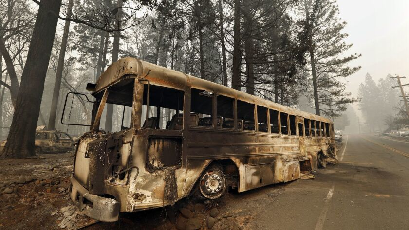 A bus that many people had to abandon to make it out of the Camp fire area, on Skyline Drive in Paradise, Calif.