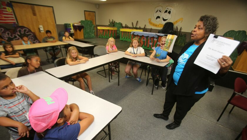 Operations and Programs Coordinator Johnnie Johnson talks with her Boys & Girls Club of Vista drama class Wednesday. The young thespians are hoping to raise money for theater chairs and upgrades to the drama room.