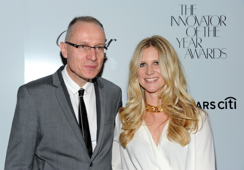 The Wall Street Journal is offering some buyouts in advance of the corporate split. PICTURED: Former Wall Street Journal managing editor Robert Thomson, who is becoming CEO of the new News Corp., and WSJ Magazine Editor in chief Kristina O'Neill.