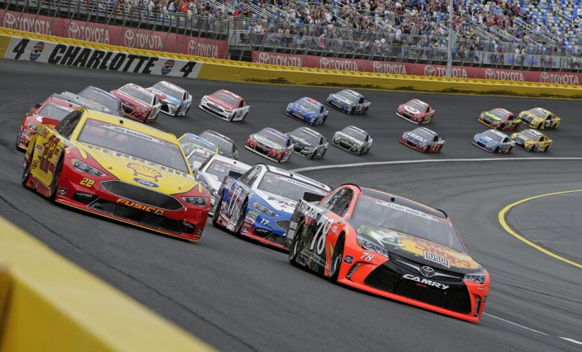 Martin Truex Jr (78) and Joey Logano (22) lead the field out of Turn 4 for the start of the NASCAR Sprint Cup series auto race at Charlotte Motor Speedway in Concord, N.C., Sunday, May 29, 2016. (AP Photo/Chuck Burton)