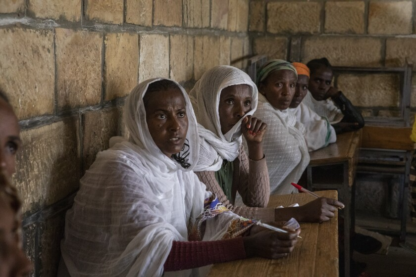 People displaced by the recent conflict listen as Manuel Fontaine, UNICEF Director of the Office of Emergency Programmes visits internally-displaced people in Adigrat Town, in the Tigray region of northern Ethiopia Monday, Feb. 22, 2021. (Zerihun Sewunet/UNICEF via AP)