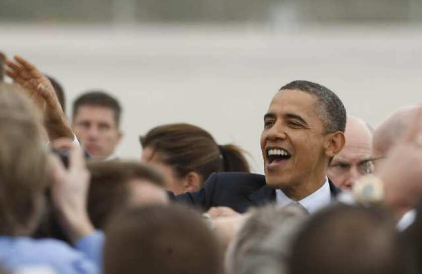 President Barack Obama greets supporters during a visit to Los Angeles in February.