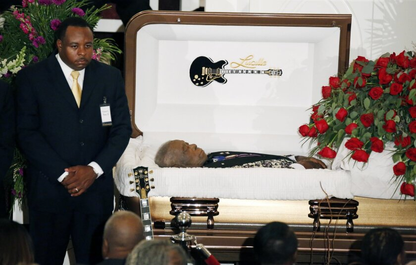 A funeral home attendant stands watch over the casket bearing blues legend B.B. King prior to his funeral mass at Bell Grove Missionary Baptist Church in Indianola, Miss., Saturday, May 30, 2015. (AP Photo/Rogelio V. Solis, Pool)