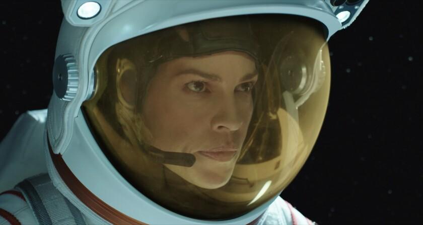 Hilary Swank as astronaut Emma Green