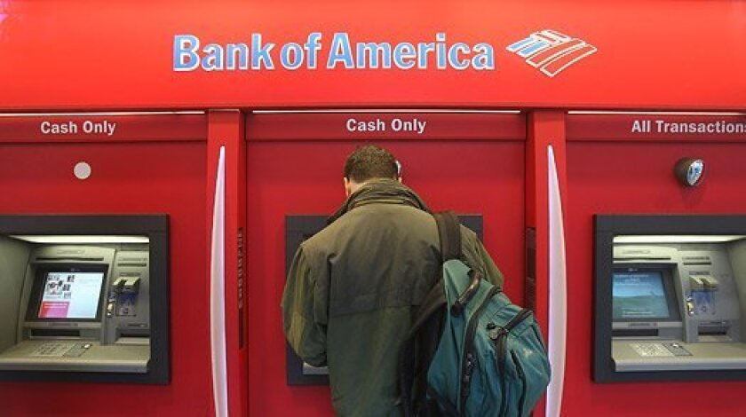 A man forced a couple at gunpoint to withdraw cash from an ATM in La Jolla late Tuesday night.