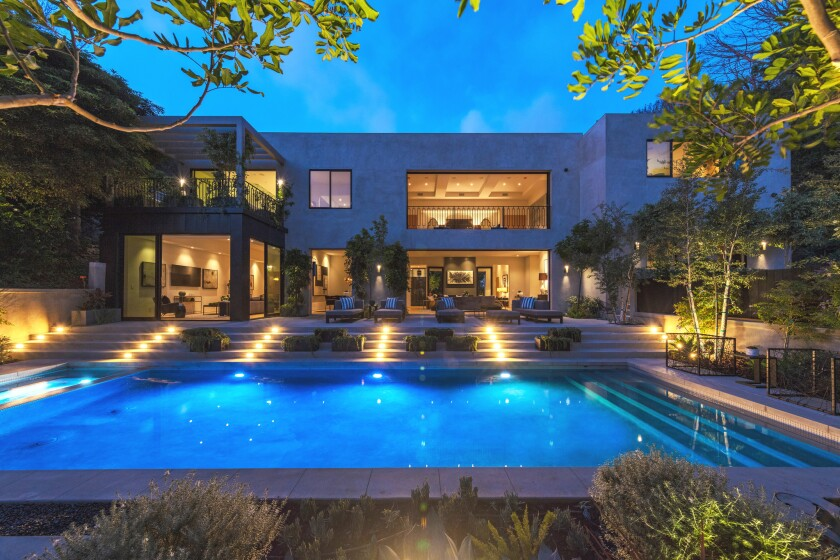 Kylie Jenner and Travis Scott have split the cost of their new place in Beverly Hills, paying a combined $13.45 million for a modern mansion.
