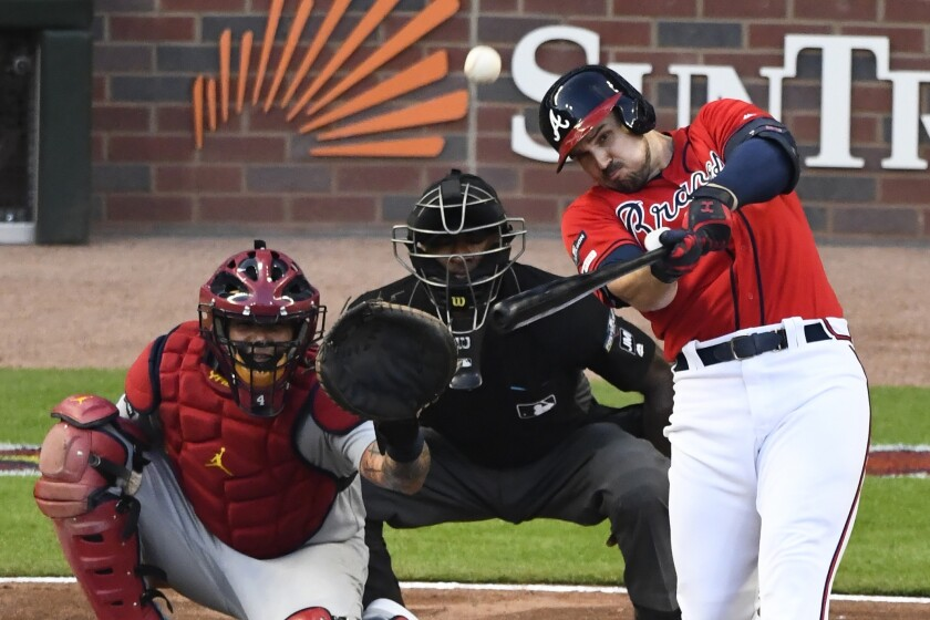 The Braves' Adam Duvall hits a two-run, pinch-hit homer in his team's 3-0 win over the Cardinals on Oct. 4, 2019.