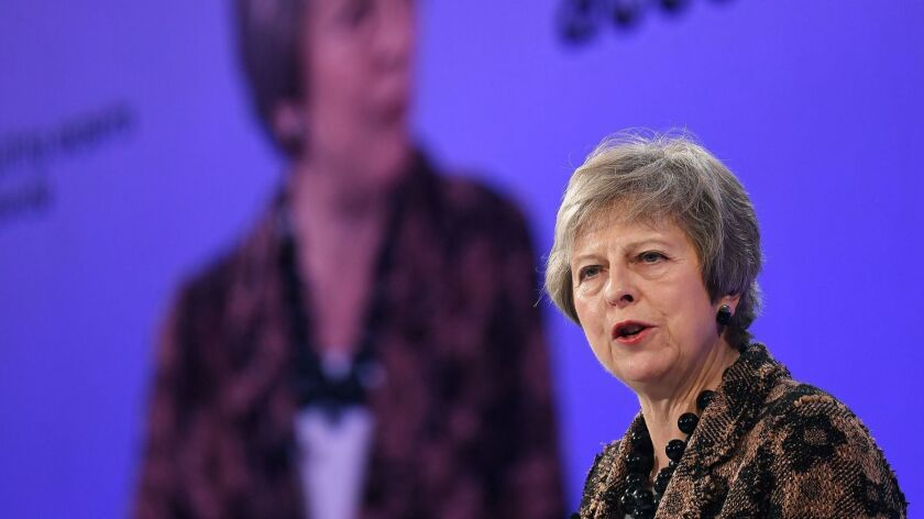 British Prime Minister Theresa May defends her Brexit deal at a business conference in London on Monday.