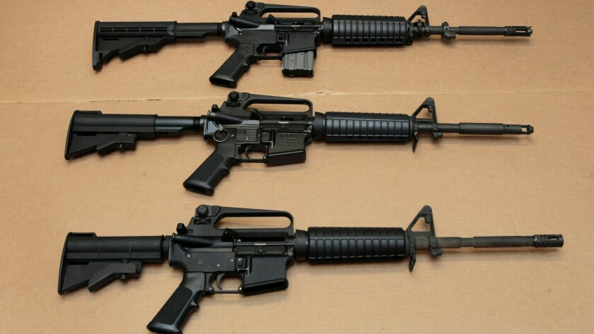 Three variations of the AR-15 assault rifle are displayed at the California Department of Justice in Sacramento.